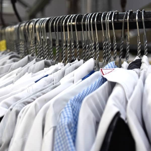 dry cleaner store with shirts on rack