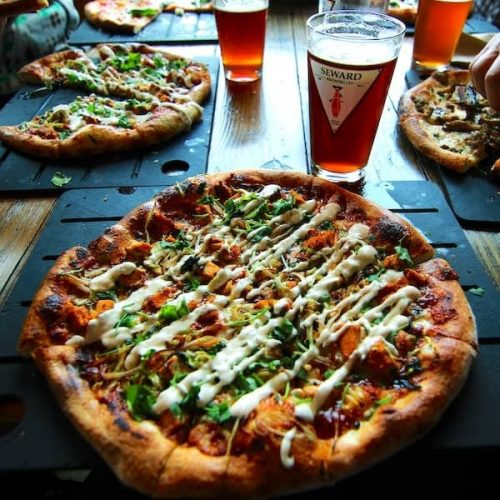pizza and beer on table